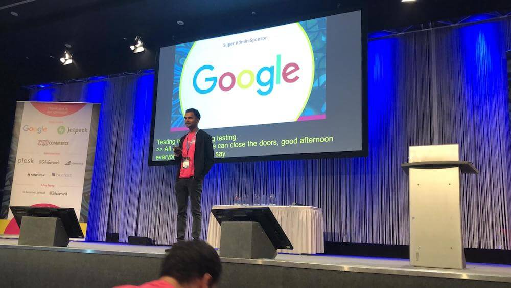 Sam on stage at WordCamp Europe 2019